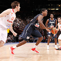 15 July 2012: Mickael Gelabale of Team France drives past Victor Claver of Team Spain during a pre-Olympic exhibition game won 75-70 by Spain over France, at the Palais Omnisports de Paris Bercy, in Paris, France.