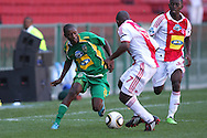 CAPE TOWN, SOUTH AFRICA - 28 MARCH 2010, Njabulo Manqana of Golden Arrows attempts to get past Enoch Shabalala of Ajax Cape Town  during the Telkom Knock Out match between Ajax Cape Town and Golden Arrows held at Newlands Stadium in Cape Town, South Africa..Photo by: Shaun Roy/Sportzpics