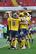 Scunthorpe United celebrate Tom Hopper of Scunthorpe United scoring goal to go 1-0 up  during the Sky Bet League 1 match between Sheffield Utd and Scunthorpe United at Bramall Lane, Sheffield, England on 8 May 2016. Photo by Ian Lyall.
