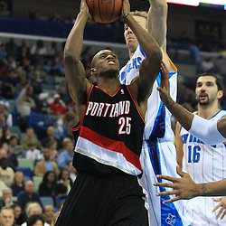 02 February 2009: Portland Trailblazers forward Travis Outlaw (25) is defended by New Orleans Hornets forward Sean Marks (4) during a 97-89 loss by the New Orleans Hornets to the Portland Trail Blazers at the New Orleans Arena in New Orleans, LA.