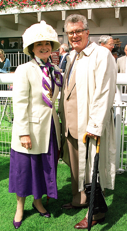 The MARQUESS & MARCHIONESS OF TAVISTOCK at a race meeting in Sussex on 4th August 2000.OGO 29