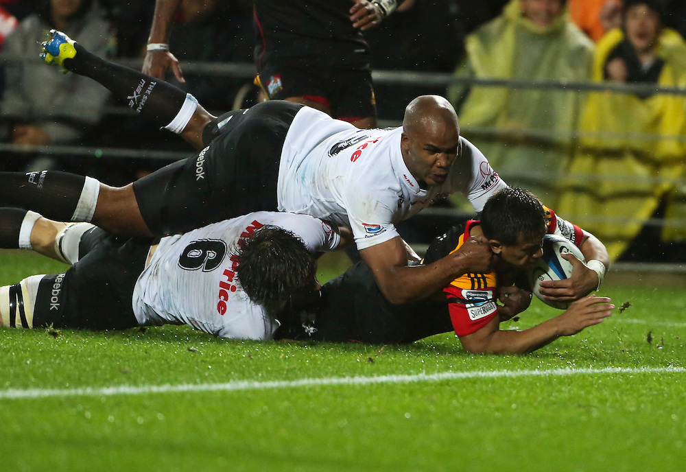 Chief's Tim Nanai-Williams dives over to score a try in the tackle of Shark's JP Pietersen in the Super 15 Rugby final match, Waikato Stadium, New Zealand, Saturday, August 04, 2012. Credit:SNPA / John Cowpland
