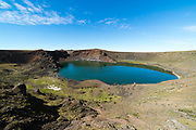 Laguna Azul, a water-filled extinct volcanic crater that is home to many birds, on the southern border of Argentina, near Rio Gallegos.