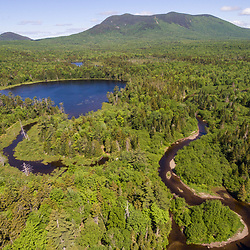 An aerial view of the West Branch of the Pleasant River, Little Lyford Pond, and Baker Mountain in Maine's 100 Mile Wilderness.