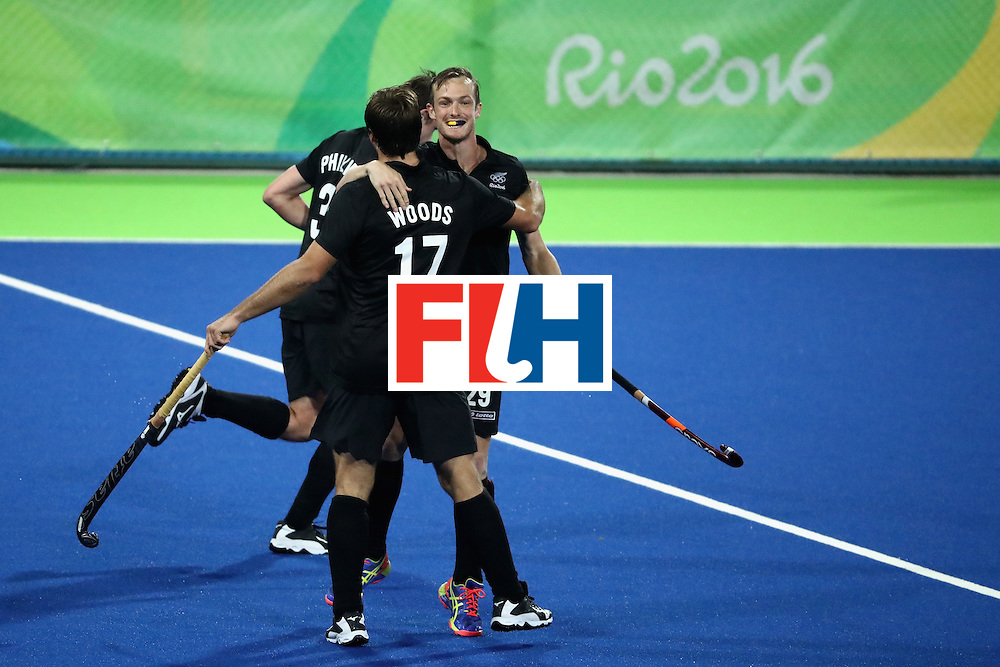 RIO DE JANEIRO, BRAZIL - AUGUST 12:  Nic Woods #17, Hayden Phillips #31, and Hugo Inglis #29 of New Zealand react to a goal against Belgium during a Men's Preliminary Pool B match on Day 7 of the Rio 2016 Olympic Games at the Olympic Hockey Centre on August 12, 2016 in Rio de Janeiro, Brazil.  (Photo by Sean M. Haffey/Getty Images)