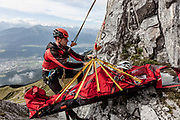 "Innsbruck, rescue operation with the team at Innsbrucker Klettersteig (via ferrata) in the rocks of the ""Nordkette"""