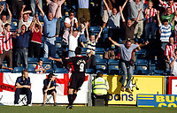 Photo: Alan Crowhurst.<br />Wycombe Wanderers v Lincoln City. Coca Cola League 2. 23/09/2006. Mark Stallard of Lincoln (C) celebrates his second goal as the Lincoln fans jump for joy.