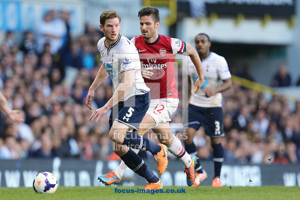Jan Vertonghen of Tottenham Hotspur and Olivier Giroud of Arsenal during the Barclays Premier League match at White Hart Lane, London<br /> Picture by Richard Calver/Focus Images Ltd +447792 981244<br /> 16/03/2014