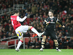 London, England - Tuesday, January 2, 2007: Charlton Athletic's Bryan Hughes and Francesc Fabregas of Arsenal during the Premiership match at the Emirates Stadium. (Pic by Chris Ratcliffe/Propaganda)