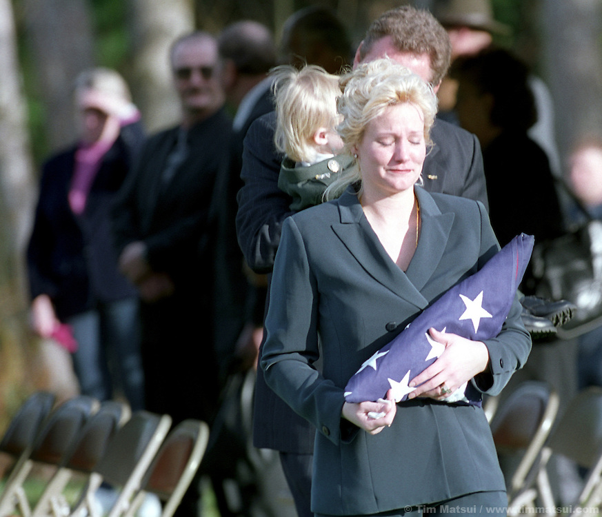Renae Chapman leaves the burial service for her husband Sgt. 1st. Class Nathan Chapman at the Tahoma National Cemetery in Kent, Washington, on Friday, January 1, 2002. Chapman was the first U.S. soldier to be killed by hostile fire in Afghanistan since ground troops were committed. He died on January 4, 2002..