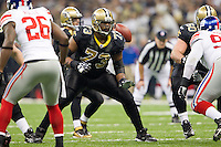 28 November 2011: Tackle (73) Jahri Evans of the New Orleans Saints blocks against the New York Giants during the first half of the Saints 49-24 victory over the Giants at the Mercedes-Benz Superdome in New Orleans, LA.