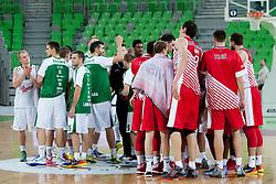 Teams of KK Union Olimpija Ljubljana and KK Crvena Zvezda Beograd after basketball match between KK Union Olimpija Ljubljana and KK Crvena Zvezda Beograd in 4th Round of ABA League 2013/14 on October 20, 2013 in Arena Stozice, Ljubljana, Slovenia. (Photo by Urban Urbanc / Sportida.com)