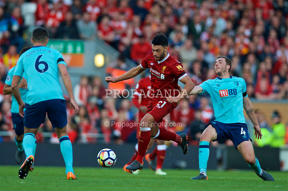 LIVERPOOL, ENGLAND - Saturday, April 14, 2018: Liverpool's Alex Oxlade-Chamberlain and AFC Bournemouth's Dan Gosling (right) during the FA Premier League match between Liverpool FC and AFC Bournemouth at Anfield. (Pic by Laura Malkin/Propaganda)