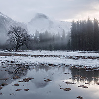 Foggy Half Dome at sunrise. Yosemite National park, CA