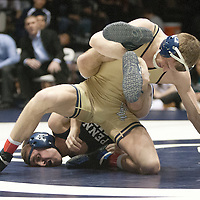 February 23, 2014; State College, PA, USA;  Clarion's Tyler Bedelyon and Penn State's Zain Retherford battle to a stalemate position in their 141-pound match at Rec Hall. Penn State defeated Clarion 43-3.