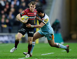 Saracens Full Back (#15) Chris Wyles is tackled by Northampton Outside Centre (#13) George Pisi during the second half of the match - Photo mandatory by-line: Rogan Thomson/JMP - Tel: Mobile: 07966 386802 30/12/2012 - SPORT - RUGBY - stadiummk - Milton Keynes. Saracens v Northampton Saints - Aviva Premiership.