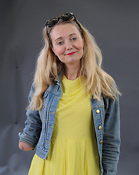 """Cerrie Burnell appears at the 2019 Edinburgh International Book Festival.<br /> <br /> Claire """"Cerrie"""" Burnell (born 30 August 1979, is an English actress, singer, playwright, children's author, and former television presenter for the BBC children's channel CBeebies.<br /> <br /> Burnell was born with a right arm that ends just below the elbow. Her initial appearance on CBeebies sparked a controversy about children's television presenters with physical disabilities and the apparent prejudice of complainants. <br /> <br /> © Dave Johnston / EEm"""