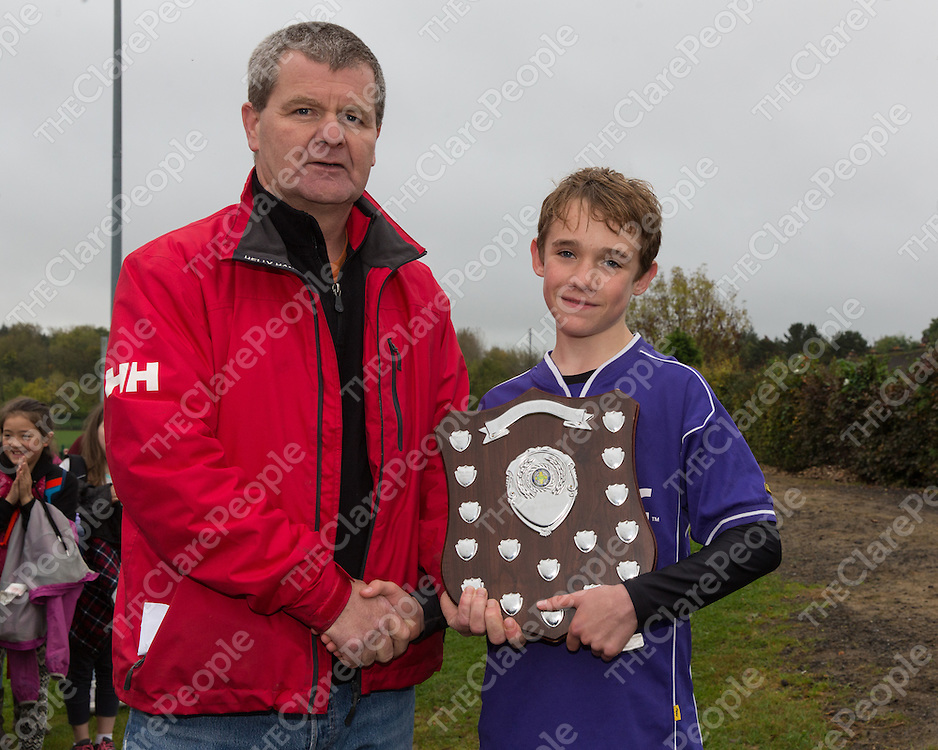 Mountshannon/ Mol an Oige's Captain Aidan Bill accepting the Boys Division 5 Shield