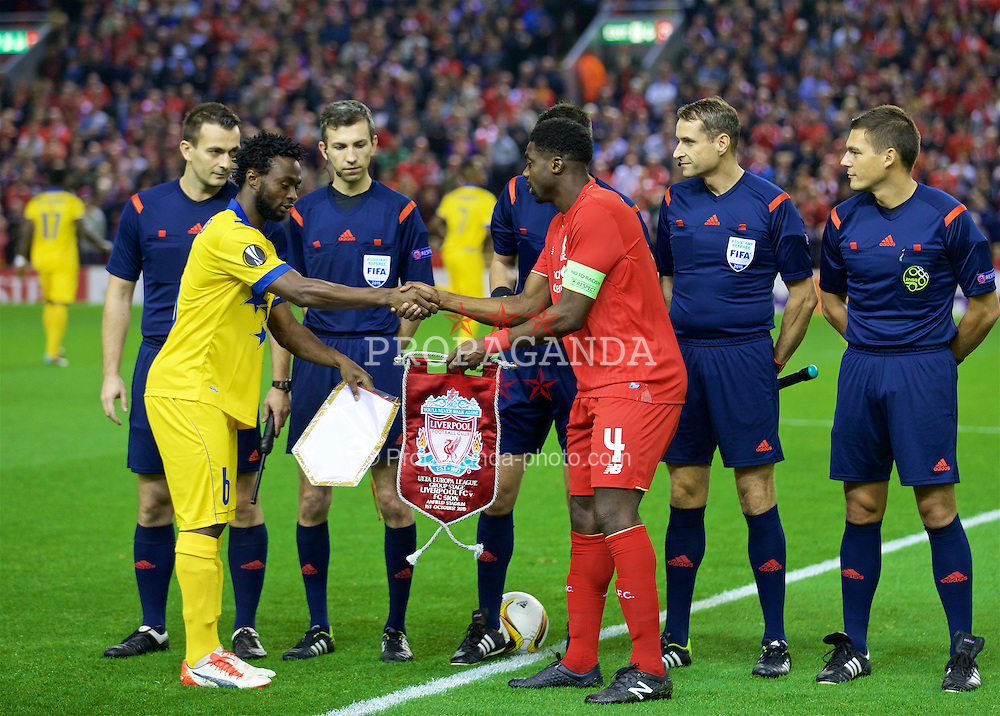 LIVERPOOL, ENGLAND - Thursday, October 1, 2015: Liverpool's captain Kolo Toure and FC Sion's captain Xavier Kouassi before the UEFA Europa League Group Stage Group B match at Anfield. (Pic by David Rawcliffe/Propaganda)