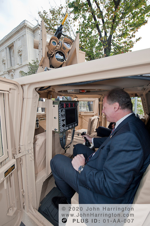 """In this photograph provided by Kongsberg Protech Systems Rep. Mark Critz (D-PA) looks at military hardware during a demonstartion on Capitol Hill on Tuesday, October 4th, 2011. Kongsberg Protech Systems was on Capitol Hill demonstrating their """"Protector CROWS"""", remote weapons station to members of Congress, senators, and their staff."""