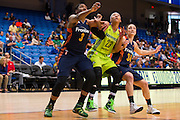 Aerial Powers of the Dallas Wings battles for a rebound against the Connecticut Sun during a WNBA preseason game in Arlington, Texas on May 8, 2016.  (Cooper Neill for The New York Times)