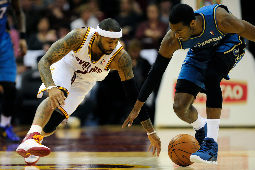 Feb. 13, 2011; Cleveland, OH, USA; Cleveland Cavaliers point guard Mo Williams (2) fights Washington Wizards point guard John Wall (2) for a loose ball during the first quarter at Quicken Loans Arena. Mandatory Credit: Jason Miller-US PRESSWIRE