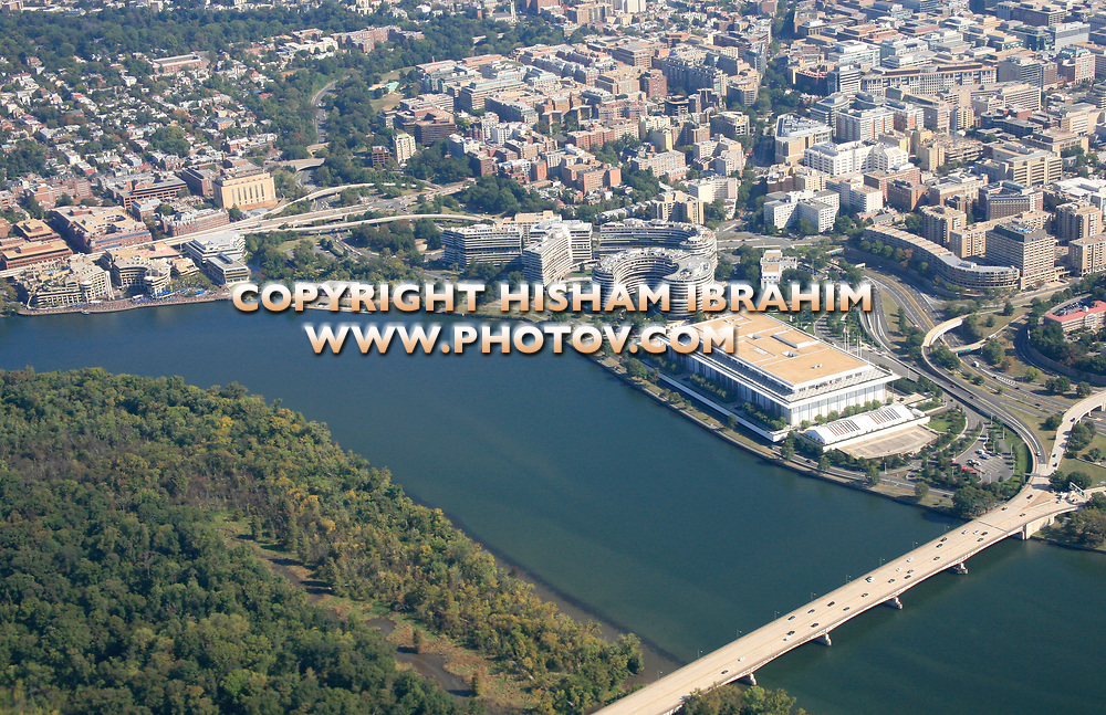 Aerial View of Washington DC featuring Georgetown Harbor, Georgetown Residential District, The John F. Kennedy Center for the Performing Arts, Watergate Complex, The Downtown District, Theodore Roosevelt Bridge, Roosevelt Island and The Potomac River.