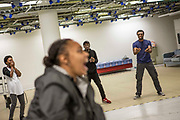 Members of the Phoenix Rising cast warm up during rehearsals in a former Santander building near Great Portland Street.<br /> The full-scale production, which runs from 8th Nov - 2nd of Dec 2017 under Smithfield Meat Market, has been put together by charity The Big House, a charity that helps troubled youths who have been in care.