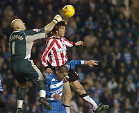 Photo: Leigh Quinnell.<br /> Reading v Southampton. Coca Cola Championship. 10/02/2006. Reading goalkeeper Marcus Hahnemann rises above Southamptons Grzegorz Rasiak.