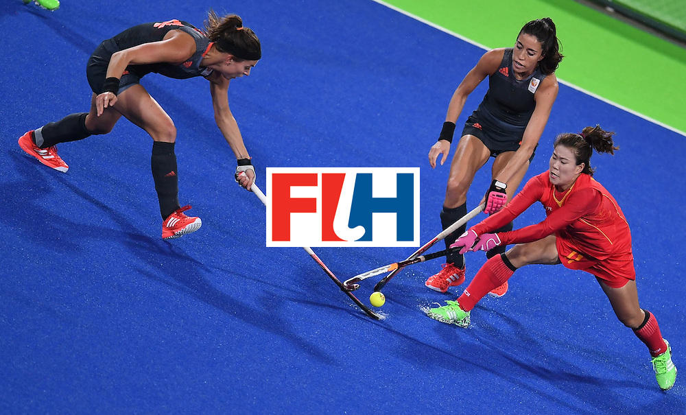 Netherland's Eva de Goede (L), Netherland's Naomi van As (C), and China's Liang Meiyu stretch for the ball during the women's field hockey China vs Netherlands match of the Rio 2016 Olympics Games at the Olympic Hockey Centre in Rio de Janeiro on August, 10 2016. / AFP / MANAN VATSYAYANA        (Photo credit should read MANAN VATSYAYANA/AFP/Getty Images)