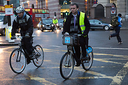 © Licensed to London News Pictures. 05/02/2014. London, UK. City workers cycling in Bank in the City of London on 5th February 2014. London Underground union members from the RMT and TSSA unions have gone on a 48 hour strike, which started at 9pm on 4th February 2014, over proposals by Transport for London (TfL) to cut jobs and close ticket offices. Photo credit : Vickie Flores/LNP