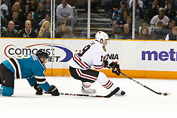 December 11, 2010; San Jose, CA, USA;  Chicago Blackhawks center Jonathan Toews (19) skates past San Jose Sharks center Joe Pavelski (8) during the first period at HP Pavilion. San Jose defeated Chicago 2-1 in overtime. Mandatory Credit: Jason O. Watson / US PRESSWIRE