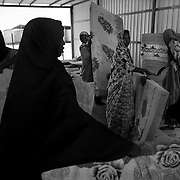 Women refugees prepare their beds at the UNHCR reception center in Ahwar. Since January some 33,600 refugees, the majority from Somalia, some from Ethiopia, have reached Yemen, but at least 400 people have drowned. The number of asylum seekers who have made it to the Yemeni shores this year has doubled from last year.