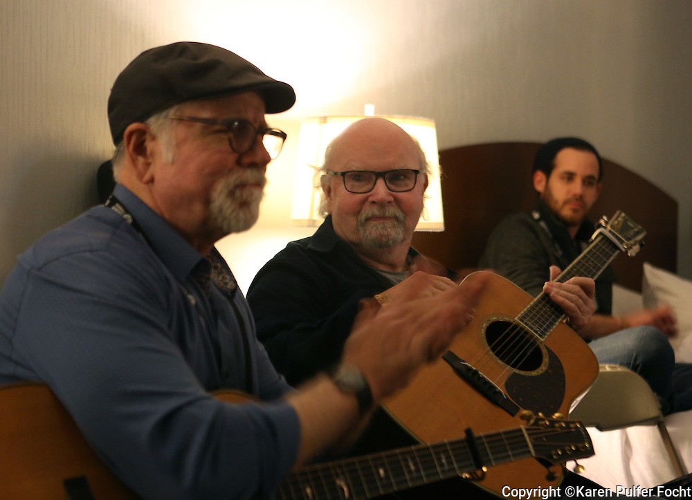 Standing room only as TOM PAXTON (rt) and JOHN MCCUTCHEON took part in a song circle at the Folk Alliance Conference in Kansas City, Missouri on Thursday Night Feb 17, 2017.