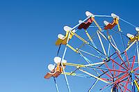 Ferris wheel against a deep blue sky.