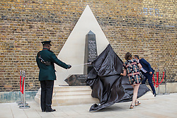 © Licensed to London News Pictures. 22/06/2017. London, UK. The African Caribbean Memorial is unveiled in Windrush Square in Brixton, south London, on Windrush Day. The memorial remembers the many African and Caribbean servicemen that fought in the Second World War. Photo credit: Rob Pinney/LNP