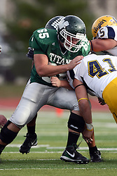 12 November 2011:  Matt Rooney holds bach Erik Westerberg during an NCAA division 3 football game between the Augustana Vikings and the Illinois Wesleyan Titans in Tucci Stadium on Wilder Field, Bloomington IL