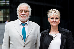 © Licensed to London News Pictures. 25/07/2014. London, UK. Veteran Radio One DJ, Dave Lee Travis with his wife Marianne arrives at Southwark Crown Court in London for a directions hearing on 25th July 2014. Photo credit : Vickie Flores/LNP