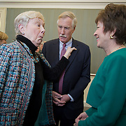 "Ellen ""Bunny"" Neff, left, sister of Senator Angus King (I-ME), remarks on his new pin as a U.S. Senator to Sen. Susan Collins (R-ME), during a reception following King's official swearing in ceremony at the United States Capitol, on Thursday, January 3, 2013.  John Boal photo/for the Press-Herald"