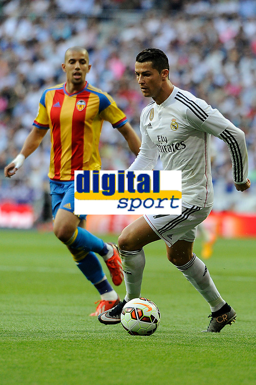 Real Madrid´s Cristiano Ronaldo and Valencia's Sofiane Feghouli during 2014-15 La Liga match between Real Madrid and Valencia at Santiago Bernabeu stadium in Madrid, Spain. May 09, 2015. (ALTERPHOTOS/Luis Fernandez)