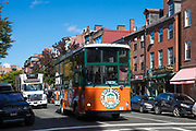 Old Town Trolley Tours in Charles Street in the Beacon Hill historic district of city of Boston, Massachusetts, USA