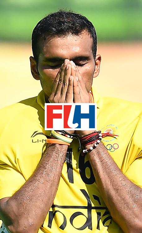India's Sreejesh Parattu reacts after loosing at the end of the men's quarterfinal field hockey Belgium vs India match of the Rio 2016 Olympics Games at the Olympic Hockey Centre in Rio de Janeiro on August 14, 2016. / AFP / MANAN VATSYAYANA        (Photo credit should read MANAN VATSYAYANA/AFP/Getty Images)