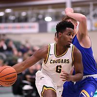 3rd year forward Shaquille Harris (6) of the Regina Cougars during the Men's Basketball home game on November 24 at Centre for Kinesiology, Health and Sport. Credit: Arthur Ward/Arthur Images