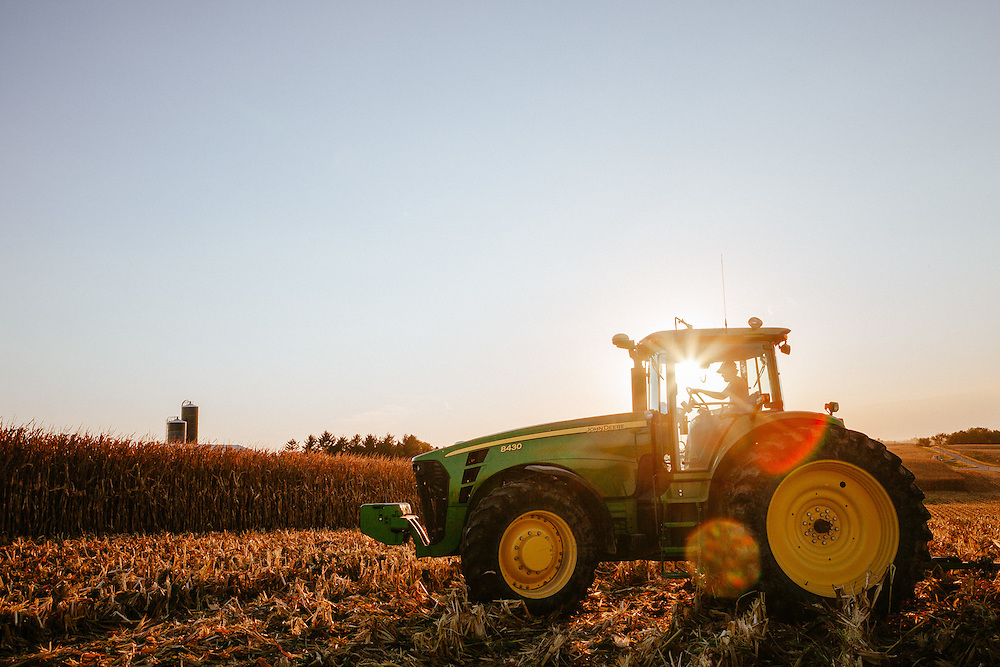 Farmer driving a tractor on the field. <br />