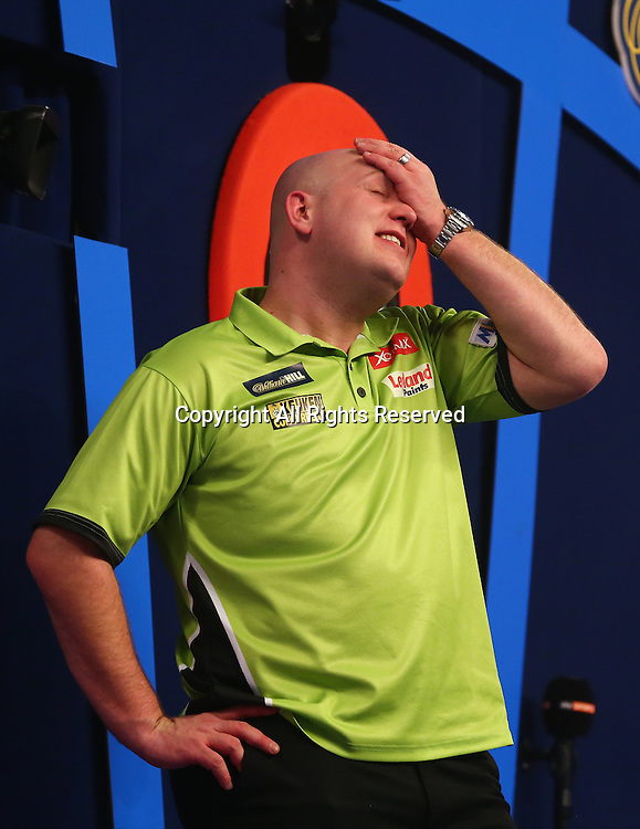 02.01.2017. Alexandra Palace, London, England. William Hill PDC World Darts Championship final  between top seeds Michael van Gerwen (1) and Gary Anderson (2). Michael van Gerwen celebrates winning the World Darts Final and wipes his brow, beating Defending World Champion Gary Anderson 7 sets to 3