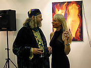 Ulla and The Marquess of Bath. Private view of 'A Vision of Romance' One Woman show of paintings by Ulla. The Atrium Gallery. Whitleys, Queensway, London. 22/2/00<br />