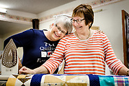 Church member Barb Bitterman (left) and Doreen Koepke, the newest member of TLC Quilters, share a moment together as they work together on Thursday, July 12, 2018, at Trinity Lutheran Church, Algona, Iowa. LCMS Communications/Erik M. Lunsford