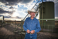 Don Schreiber on his ranch in Blanco, New Mexico. He is standing infront of one of the wells recently redrilled on BLM land that he leases. <br /> The Schreiber's own over 400 acres and lease hundreds more from the BLM. They do not own their mineral rights so they are have to contend with the fracking industry on their land. They successfully took on industry and the BLM, persuading them to twin existing drill sites instead of drilling hundreds of new ones.
