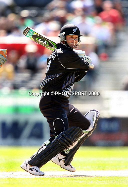 Black Caps batsman Nathan Astle hits out during the third ODI cricket match between the Black Caps and West Indies at Jade Stadium, Christchurch, New Zealand, on Saturday 25 February, 2006. New Zealand won the match by 21 runs to win the 5 match series 3-0. Photo: Andrew Cornaga/PHOTOSPORT.<br />