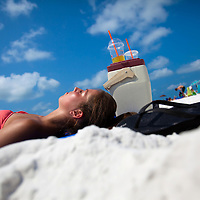 SARASOTA, FL -- June 14, 2011 -- Cassie Bonenfant, 18, who uses SPF 30 on her face and SPF 8 on her body, lays out on under the sun on vacation from Western New England College at Siesta Public Beach in Sarasota, Fla., on Tuesday, June 14, 2011.